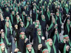 Lebanese Hezbollah supporters march for Ashura, a holy day, in Beirut's suburbs in December.