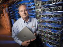 Beating back opposition from big telecoms:  Terry Huval, director of Lafayette Utilities System Fiber, stands near video encoders at the utility's data center in Lafayette, La.