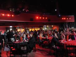 Attendees enjoy a show after The Joy Theater's multimillion-dollar renovation in New Orleans.