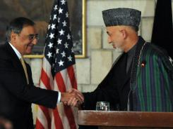 Afghan President Hamid Karzai shakes hands with U.S. Defense Secretary Leon Panetta during a joint press conference in Kabul on Dec. 14.