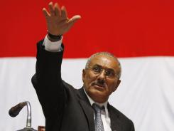 Yemeni President Ali Abdullah Saleh gestures during a gathering of supporters in Sanaa.