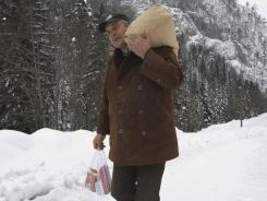 Emin Hotovic, 55, carries groceries to his village of Hotani, near the Bosnian town of Kladanj, on Thursday. Heavy snow blocked roads.