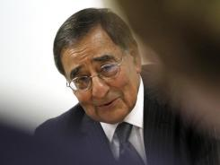 U.S. Defense Secretary Leon Panetta answers questions from members of the traveling press after concluding a day of NATO Ministers of Defense meetings Thursday in Brussels.