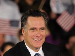 Republican presidential hopeful Mitt Romney greets supporters in Columbia, South Carolina.