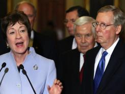 Manager of the bill Sen. Susan Collins speaks to reporters as Sen. Mitch McConnell (R-Ky) looks on at the U.S. Capitol.
