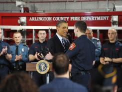President Obama greets firefighter and Iraq War veteran Lt. Jacob Johnson before taking the stage to speak on jobs for veterans Friday at Fire Station #5 in Arlington, Va.