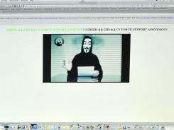 Monitors display the hacked Greek ministry of justice website on Friday.