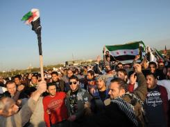 Kuwaiti citizens and Syrians resident in Kuwait protest Saturday in front of the Syrian Embassy in Mishref, Kuwait City on Saturday,
