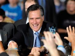 Mitt Romney greets supporters during an election party Saturday at the Red Rock Casino in Las Vegas.
