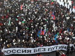 "Protesters march in an anti-Putin rally in Moscow on Saturday. The white banner reads: ""Russia without Putin and for fair elections."""