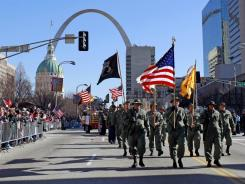 A parade honoring Iraq War veterans was held in St. Louis on Jan. 28. Some Iraq vets are pushing for a ticker-tape parade in New York to mark the end of the war, but the White House has opted for a state dinner.