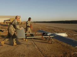 Soldiers prepare to launch a drone over the province of Diyala, Iraq.