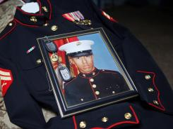 Itzcoatl Ocampo's dress uniform, government military photo and dog tags lie on display at Ocampo's home in Yorba Linda, Calif. Ocampo, 23, is a suspect in a series of killings of homeless men in Orange County, Calif. and is facing two additional murder charges.