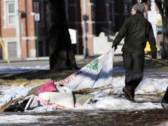 A man drags a collapsed tent as members of Occupy Portland dismantle the encampment on Monday.