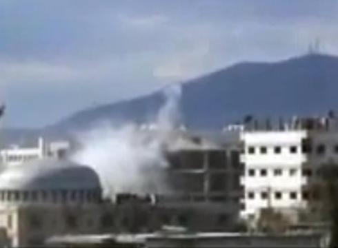 This image from amateur video purports to show an explosion in Damascus, ...