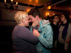 Kara Haney, left, and Kate Wertin, embrace in Seattle's Lobby Bar as the Washington state Senate passes a same-sex marriage bill.