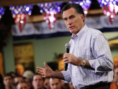 Republican presidential hopeful Mitt Romney holds a campaign rally at RV America in Loveland, Colo., on Tuesday.