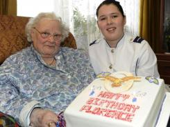 Florence Green is presented with a birthday cake on behalf of the Royal Air Force at her home in King's Lynn, England, on Feb. 19, 2010.