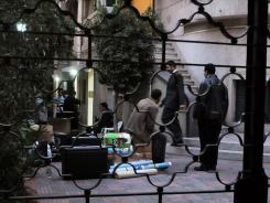 Egyptian police raid a non-governmental organization office on Dec. 29 in Cairo.