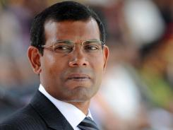 Maldivian President Mohamed Nasheed looks on while attending a military parade in the central Sri Lankan town of Diyatalawa. Nasheed announced his resignation Tuesday following weeks of public protests over his controversial order to arrest a senior judge.