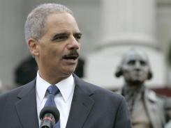 U.S. Attorney General Eric Holder addresses the crowd during a rally on Jan. 16 in Columbia, S.C. Hundreds of people gathered to honor the Martin Luther King Jr. holiday and protest the state's voter identification law.