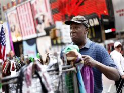 Duane Jackson sets up his sales stand while talking to reporters in Times Square on May 2, 2010.