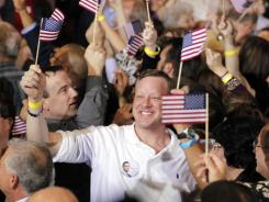Supporters of Mitt Romney cheer the closing of the polls at his Florida primary night rally in Tampa on Jan. 31.