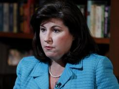 Quit breast cancer foundation: Karen Handel discusses her resignation Tuesday in Atlanta.