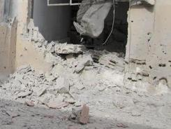 A house in the Baba Amr neighborhood of Homs province shows damage from Syrian government forces' shelling.
