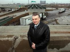 Dan Stamper, president of Detroit International Bridge Co stands in front of a gap in the ramp that will carry trucks from the Ambassador Bridge to nearby interstate highways.