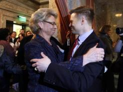 Likely to be signed into law: Washington Gov. Chris Gregoire and Rep. Jamie Pedersen, D-Seattle, celebrate Wednesday's vote.