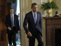 President Obama heads to the stage with Education Secretary Arne Duncan, left, to speak about flexibility for states in the No Child Left Behind law at the White House Thursday.
