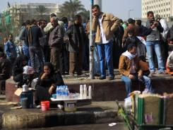 Street vendors sell refreshments and other goods in Cairo's Tahrir Square where protesters and debaters still gather, a year after the uprising.