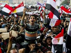 Anti-goverment demonstrators shout slogans in Cairo's Tahrir Square on Feb. 10, 2011. A year after the revolution, many Egyptians see an undemocratic society where little is changing.