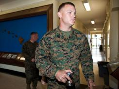 Sgt. Benjamin Johns walks to the courtroom of the Marine Corps Base Hawaii Legal Services Center on Jan. 30.