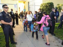Students return to Miramonte Elementary School on Thursday after a two-day closing. After abuse allegations surfaced, the school district removed the entire school staff.