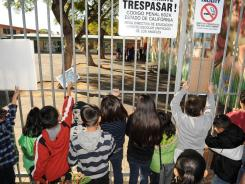 Children who did not return to classes at Miramonte Elementary School in Los Angeles Thursday waited for their parents to emerge from a teacher/parent meeting from outside.