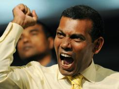 Former Maldives president Mohamed Nasheed attends Thursday's Maldivian Democratic Party meeting in the capital of Male.
