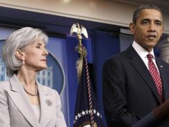President Obama, accompanied by Health and Human Services Secretary Kathleen Sebelius, announces the revamp of his contraception policy Friday in Washington.