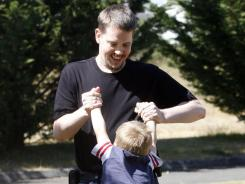 Josh Powell plays with his son Braden in a park near his home, in Puyallup, Wash., in May 2011.