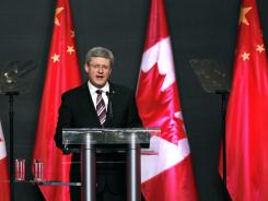 Canadian Prime Minister Stephen Harper delivers his speech on February 10 in Guangzhou, China, announcing desires to sell oil to China and promoting stronger relations between both countries.