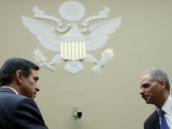 Chairman Darrell Issa, R-Calif., left, greets U.S. Attorney General Eric Holder at a House Oversight and Government Reform Committee hearing on Operation Fast and Furious in Washington last week.
