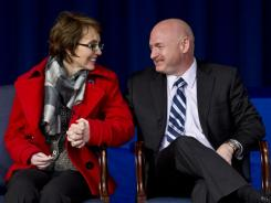 Former Arizona congresswoman Gabrielle Giffords and her husband, Mark Kelly, attend the unveiling of the USS Gabrielle Giffords at the Pentagon on Friday.
