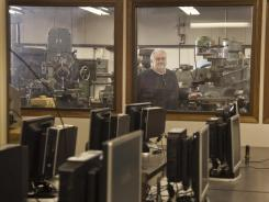 Ted Casper of Edgerton, Wis., stands for a photograph in a machine shop at Blackhawk Technical College in Janesville, Wis., on Jan. 27.
