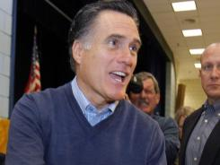 Republican presidential candidate Mitt Romney greets a supporter at an election caucus Saturday in Portland, Maine.