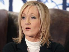 "This December 2008 file photo shows author J.K. Rowling reading passages from her new book ""The Tales of Beedle the Bard"". J.K Rowling is among those who were allegedly targeted in the British phone hacking scandal. On Saturday, five The Sun tabloid employees were arrested in bribe inquiry."