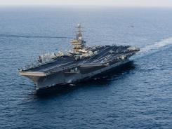 This Jan. 19 image provided by the U.S. Navy shows the Nimitz-class aircraft carrier USS Abraham Lincoln on its way to the Strait of Hormuz.