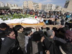 Mourners carry the body of a Syrian rebel the day after he was killed in fighting in Idlib, Syria, on Sunday.