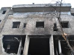 A building said to have been destroyed by Syrian government forces shelling, in Homs province.