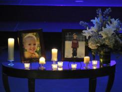 Photos of Charlie, right, and Braden Powell are displayed during their funeral service on Feb. 11 in Tacoma, Wash.